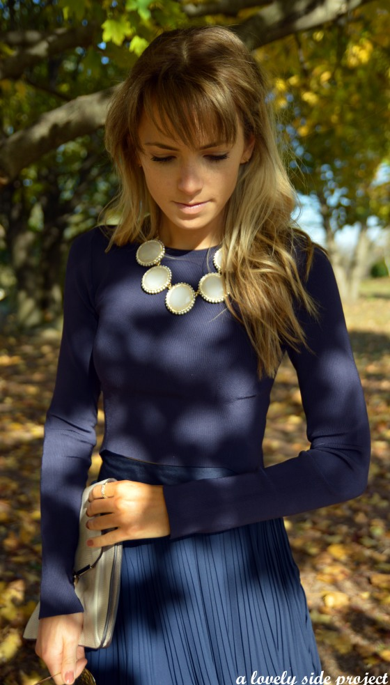 navy with statement necklace